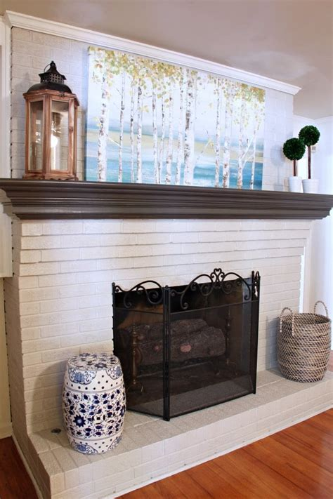 painted brick fireplace dated brick fireplace gets painted white angie s list