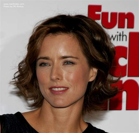 Tea Leoni wearing her hair short at chin length with curls