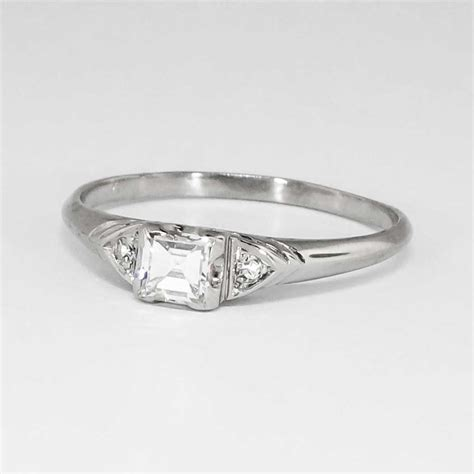 Elegant Understated 1940's 30ct Tw Square Emerald Cut. Galaxy Engagement Rings. Lavender Engagement Rings. Messika Rings. Amethyst Side Stone Wedding Rings. Oval Shaped Rings. Tiny Pink Diamond Rings. Raw Crystal Wedding Rings. Barbie Rings
