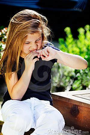 girl biting nails royalty  stock images image