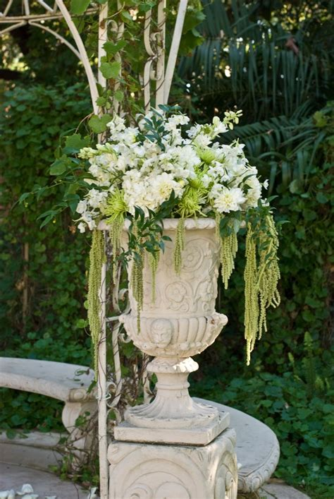 urn  draping flowers   ceremony container