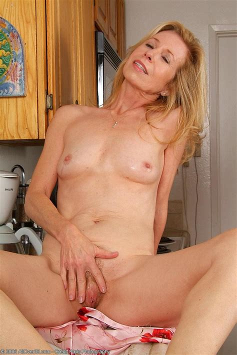 Over 50 Blonde Mature Housewife Shows Off Hairy Pussy