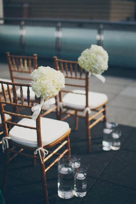 white flower bouquets ceremony chair decor elizabeth