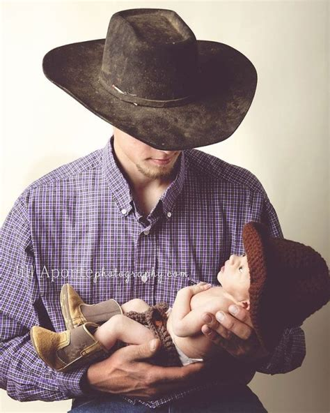 newborn photography posing cowboy boots hat father dad