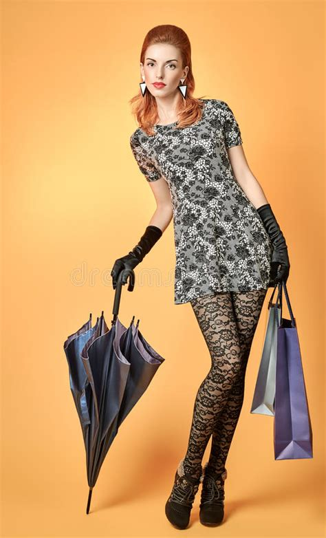 fashion beauty woman holding shopping bags vintage stock