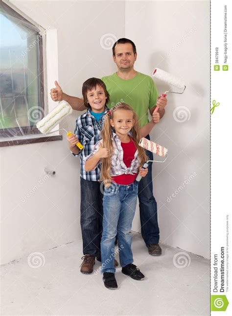 Kids With Their Father Preparing To Paint The Room Royalty