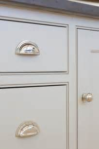 grey kitchen cabinetry and polished nickel handles at the