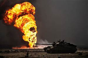 An Abandoned Iraqi Tank In Front Of The Burning Magwa Oil