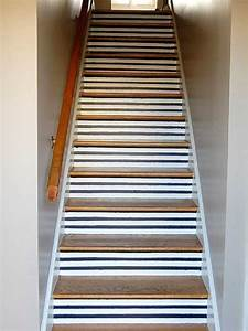 17 best images about ideas for our stair risers on for Best brand of paint for kitchen cabinets with wall art for staircase wall