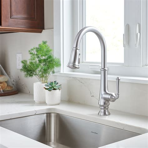 pictures of kitchen sinks and faucets delancy pull kitchen faucet american standard 9113