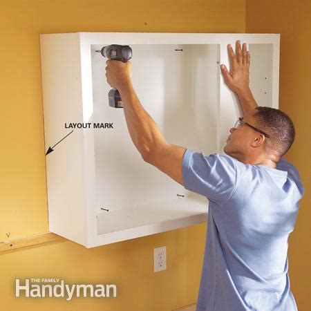 how to install upper cabinets installing kitchen cabinets the family handyman