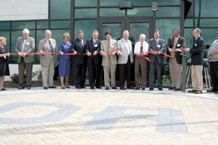 dresser rand cuts ribbon at new building news