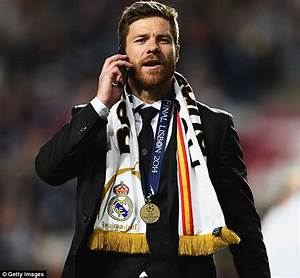 Real Madrid's Xabi Alonso shakes his head at Platini over ...