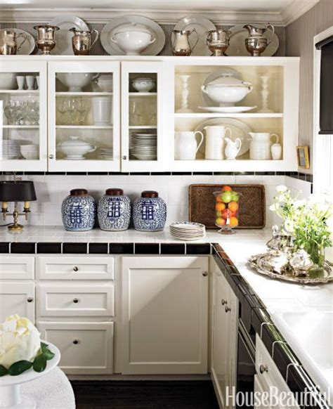 Decorating Ideas For Kitchen Cabinet Tops by 14 Genius Ideas For The Awkward Space Above Your Kitchen