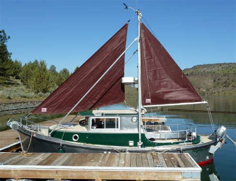 Small Displacement Motor Boat by Stabilizer Systems And Auxillary Sails Tad Yacht