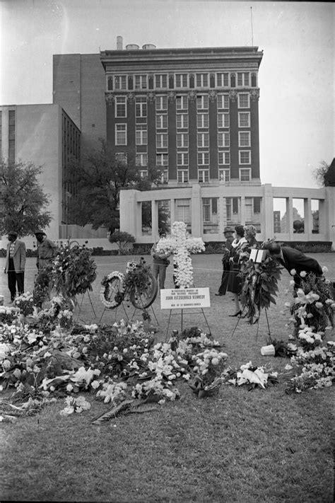 [Memorial flower arrangements in Dealey Plaza on November