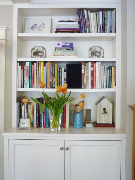 Dressing Up Your Bookshelves With Paint Or Wallpaper