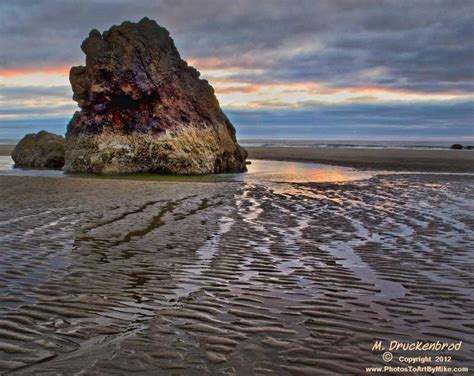 a rock sea stack at low tide on cannon beach oregon flickr