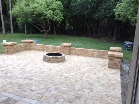 Paver Brick Wall by Paver Patio Area With Pit And Sitting Wall