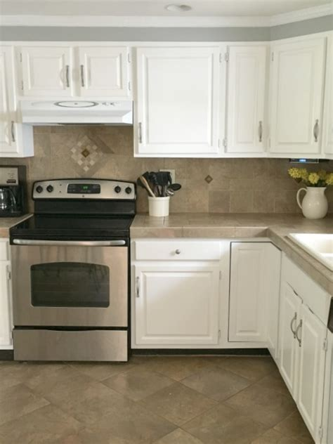 best way to paint kitchen cabinets white the easier way to paint kitchen cabinets just call me