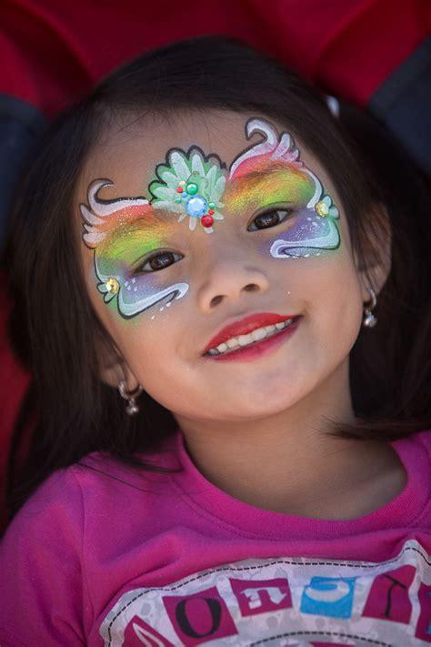 smiling girl  face paint alaska state fair