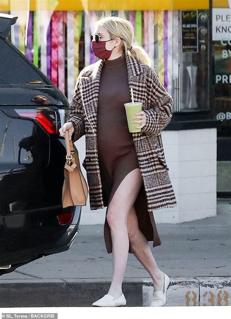 Pregnant Emma Roberts cuts a chic figure figure in a plaid ...