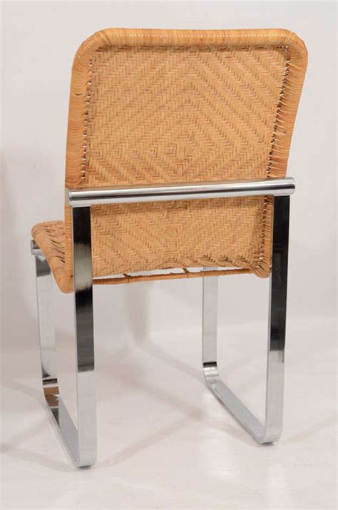 rattan and chrome dining chairs by stendig at 1stdibs