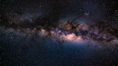 Galactic Collision Could Wake Up Milky Ways Dormant Black
