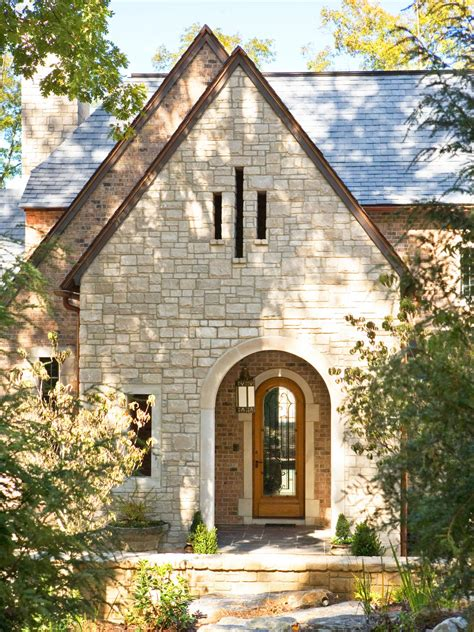 Stone Home Exterior With Arched Entry And Front Door