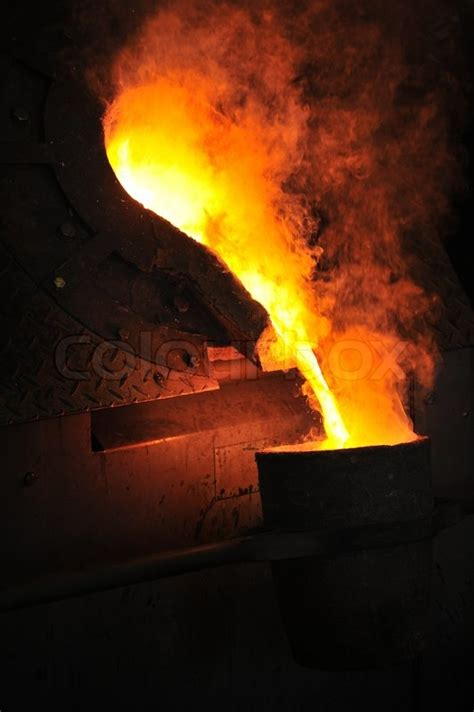 Foundry - molten metal poured from ...   Stock image ...
