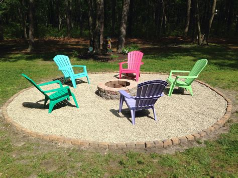 Backyard Chairs by Backyard Pit With Pebble Rock And Adirondack Chairs