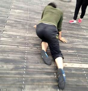 Chinese company staff are forced to crawl in public after ...