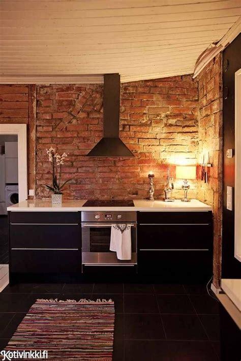 unelmien hirsitalo exposed brick kitchen brick wall
