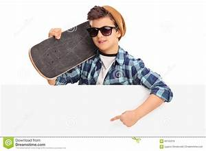 Cool Skater Boy Pointing On A Blank Panel Stock Photo ...