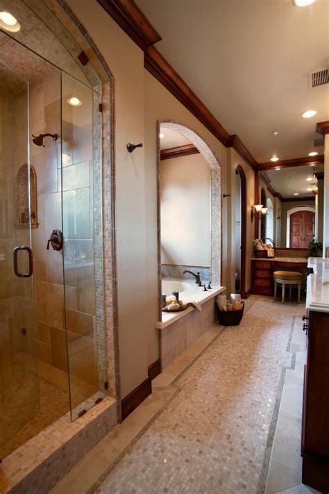 long master bathroom  small tile floor glass door