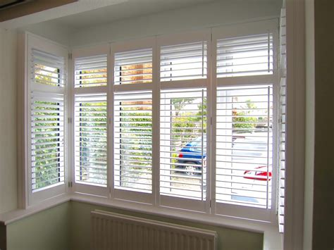 bay window plantation shutters fitted in forest