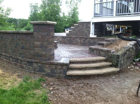 unilock stack nardelli works concord wall with brussels sitting