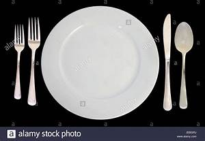 This is a place setting including one white dinner plate ...