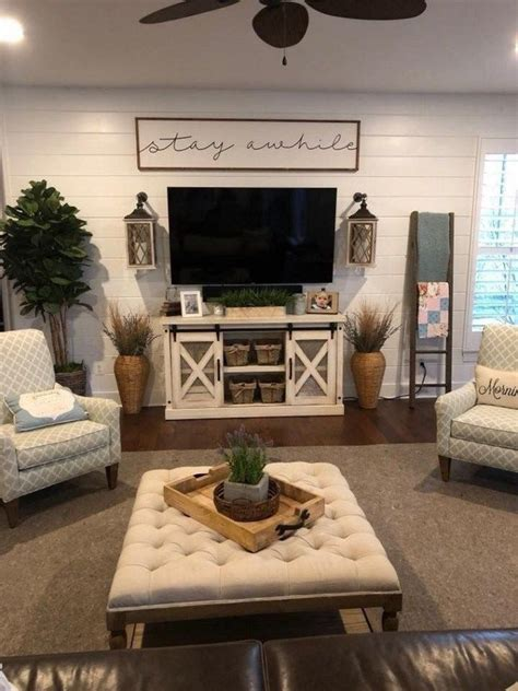 This sunroom/living room features large windows and vaulted ceilings. 43 amazing farmhouse home decor ideas to get a past impression 30 | Wall decor living room ...
