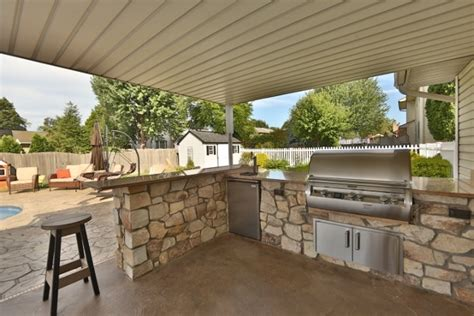 an customized covered outdoor kitchen right when you walk