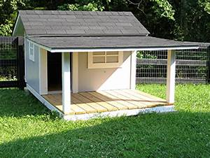 Custom doghouse with kentucky style fence gathering wood for Large dog house with porch