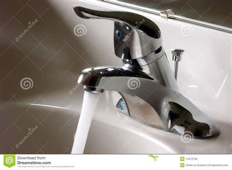 Bathroom Faucet Open And Running With Water Flow Stock