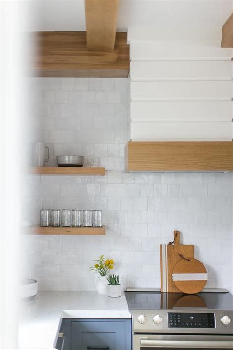 blond floating shelves  shiplap walls transitional