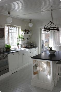 wood kitchen flooring kitchen design white tiled splashback patterned tile 1142