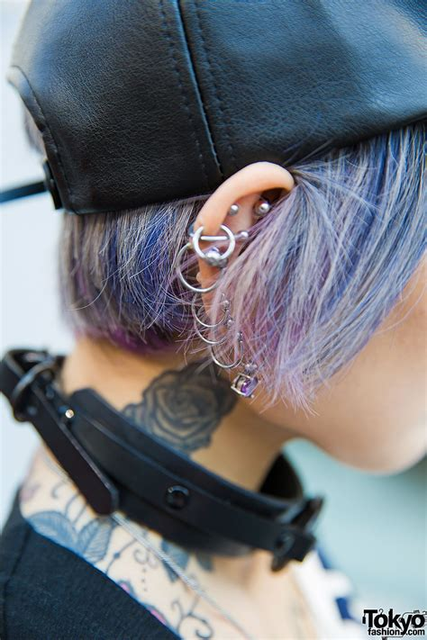 blue haired harajuku girl  piercings tattoos worlds  vivienne westwood dr martens