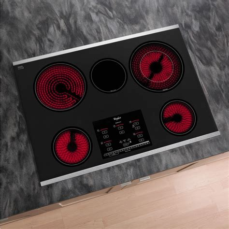 cooktop whirlpool electric radiant elements stainless steel surface burners smoothtop indicator lights gold accusimmer controls touch kitchen plus series cooktops