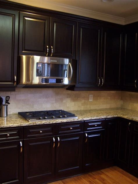 Espresso stained kitchen cabinetry.   Kitchen cabinetry
