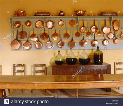 rows  copper pots  pans  wooden wall rack  sideboard  stock photo  alamy