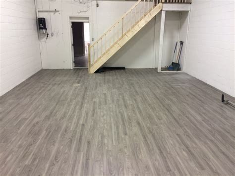 linoleum flooring for garage click vinyl floor install in warehouse industriale garage toronto di weston flooring