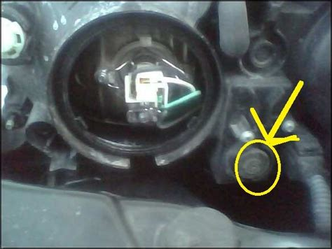 2008 kia spectra headlight adjustment i ve searched